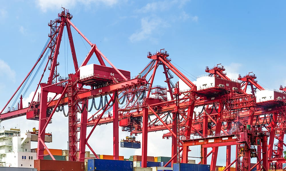 Image of container cranes offloading shipping containers from a ship